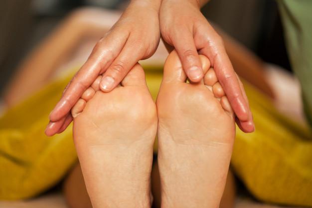 masaje de pies beneficios